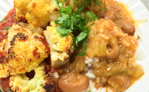 Cauliflower Steaks in Curried Tomato Sauce w/ Red Beans + Rice